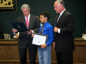 Charles Warren, 10, honored at Lexington 2 Board meeting