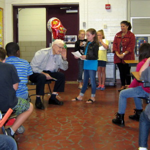 Volunteer Reader Harvey Johnson celebrated by Pineview Elementary