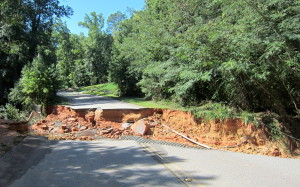 Raging water takes chunk out of Botanical Parkway