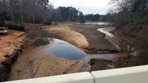 Run-off sediment fills lake bed on Saluda River Drive