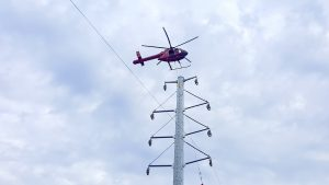Helicopter buzzing West Columbia for SCE&G's new power line installation