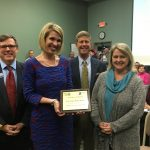 Principal Megan Carrero and Allison Swygert receiving the Top Contributor of the Lex. 2 middle schools.