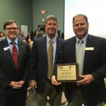 Principal Brad Coleman from Airport High School receiving the Top Contributor of the Lex. 2 high schools.