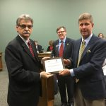 Superintendent Dr. Bill James receiving the Top Campaign Contributor.