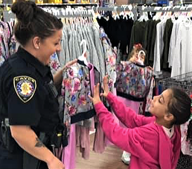 Cayce Public Safety  conducting Shop with a Cop for children