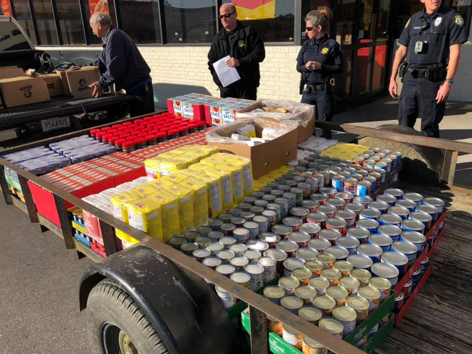 Cayce Public Safety, Lexington County officers distributing food baskets for Christmas